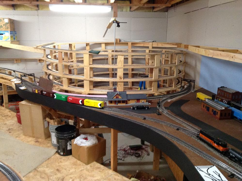 Kids acquire to work Lionel train table plans with their manpower and.