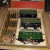 DSC01591: 1 short body loco, 2 passenger carriages, brass rail oval track