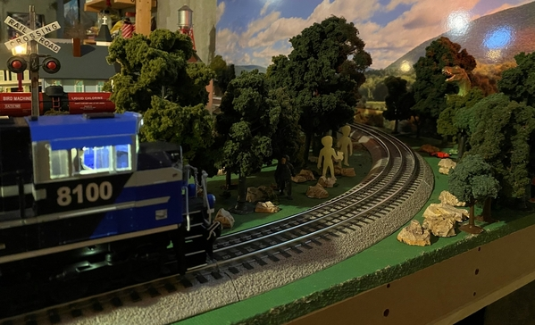 CN 8100 ventures into danger with Bigfoot Aleins and a T-Rex