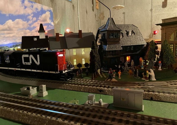 CN GP9 tries to sneak past a Lionel haunted house
