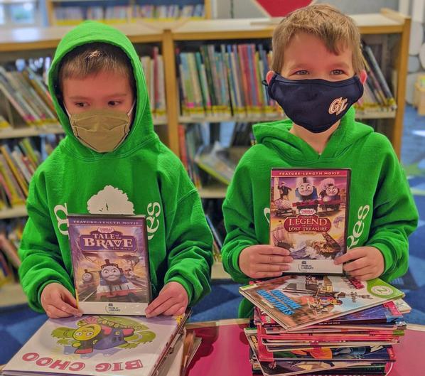 5 Boys at library