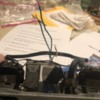 6: wires come out top of batter compartment