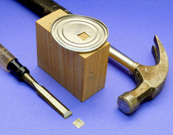 punch tin with wood chisel on end grain hardwood block