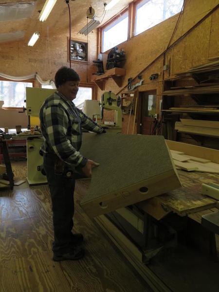 Straightforward Layout, Ray lifting platform off table in carpentry shop