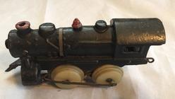 unknown cast iron loco with plastic wheels other side