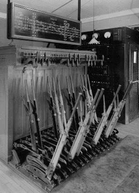 INTERLOCKING TOWER INTERIOR SHOWING CONTROL LEVERS AND TRACK BOARD