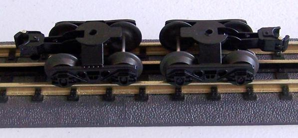 LIONEL PLASTIC SIDE FREEROLLING O TRUCKS