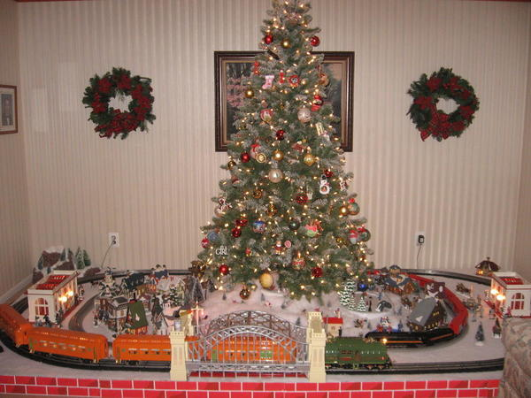 just finished up yesterday i love trains under the tree my outer loop is standard gauge while the inner is o gauge fastrack