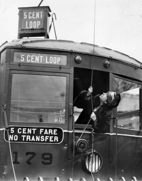 "Seattle's Mayor Bertha Landes set the trolley lines on one of the city's red streetcars that made a bargain ""loop"" through the downtown business area in 1927"