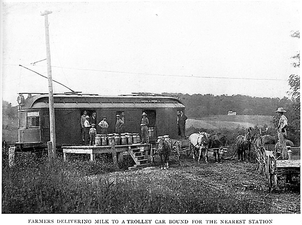 FarmersDeliveringMilkToATrolley