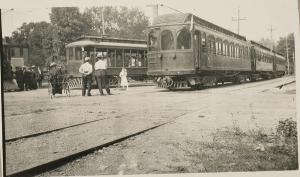 three cars on the main line, and an open car on the Auburn and Northern being loaded for a trip to the park in Auburn