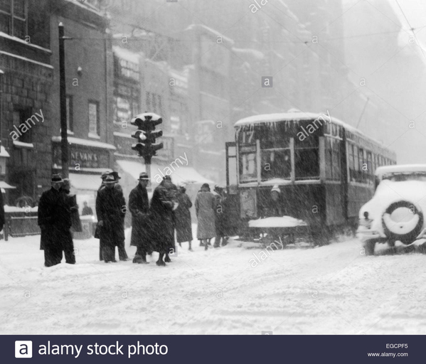 1930s-pedestrians-on-snow-covered-icy-winter-street-in-philadelphia-EGCPF5