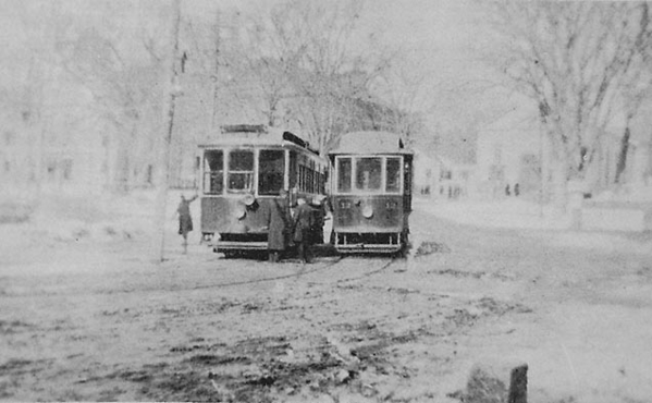 CM&H 12 Meets Lexington & Boston Car11 in Monument Square, Concord. [December 1908)