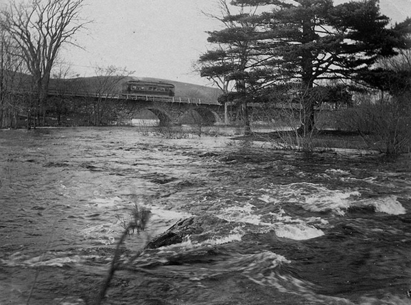 CM&H Car crosses Assabet River via the Great Road bridge, circa 1903.
