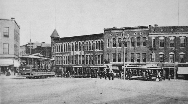 CM&H Cars in Wood Square, Hudson. [circa 1910)