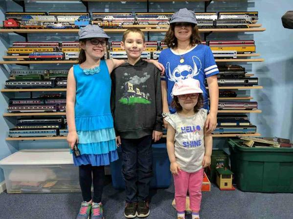 Kids in front of train shelves 2017-04-14
