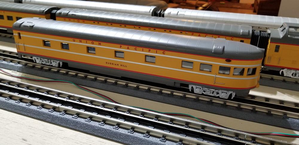 Switching back to high rail trucks for 70 ft  passenger car