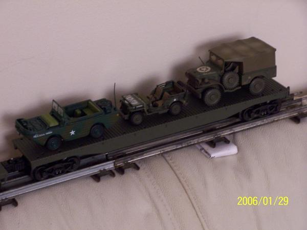 100_4351 Army amphibian, jeep and .75 tn truck on flat