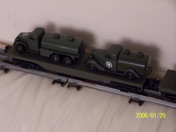 100_4352 2 Army fuel trucks on flat