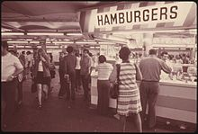 220px-HAMBURGER_STAND_OFFERS_CUSTOMERS_A_QUICK_BITE_WHILE_WAITING_FOR_THEIR_SUBWAY_TRAIN_ON_THE_42ND_STREET_STATION..._-_NARA_-_556816