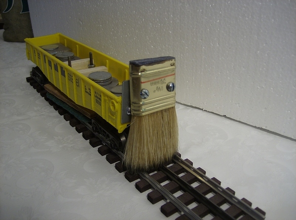 Track cleaner with brush