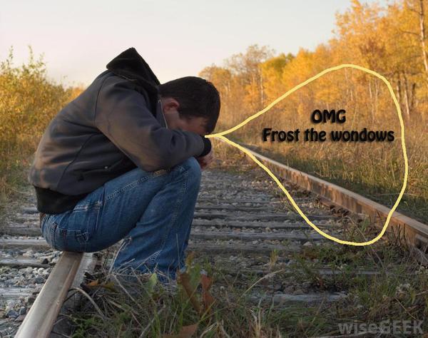 man-sitting-on-railroad-tracks