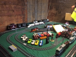 One of 3 model railroads they had set up in a refrigerator car