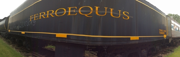 A panorama of no. 2100's tender in storage outside.