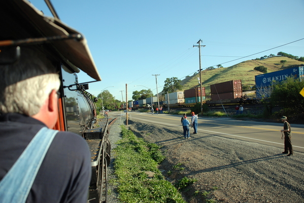 Waiting to Cross the Street with Conatainer Train in Background